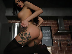 Tattooed Brunette Gets Naked